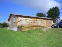 40 x 20 Log Cabin with garden office doors & windows. Customer lined building for holiday letting.
