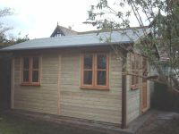 8 x 12 Workroom with Garden Office door, and windows.