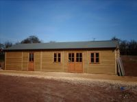 40 x 20 Farm Shop with green felt roof, and garden office doors & windows.