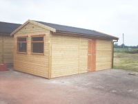 Self Erected Hobby / Workroom with large garage windows and onduline roof. Building made to match farm shop.