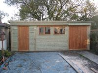 22 x 11 Pent Roof Workroom with framed ledged & braced doors. Also features 2 garage windows with grilles