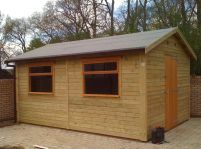 8 x 12 Workroom with 2 - large garage windows and a standard door.
