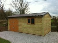 18 x 10 Workroom with double doors, and a garage window. This building has brown Rollaclad metal sheeting roof.