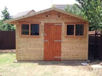 12ft wide Workroom with standard windows and door all on the front gable end.