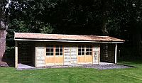 30 x 12 Building with log stores at both ends, with cedar shingles.