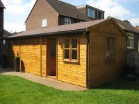 10 x 30 Workroom with a Felt Tile Roof, and garden office door and windows.