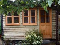 Workroom in Feather Edge Cladding. With Garden Office door and windows.